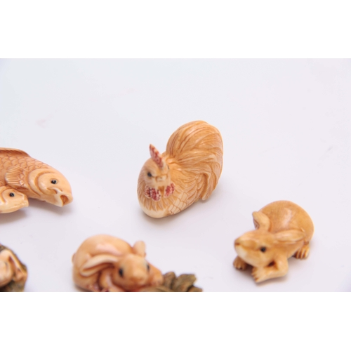 186 - A COLLECTION OF SEVEN EARLY 20TH CENTURY IVORY NETSUKE sculptured as rabbits, fish, hen, and octopus...