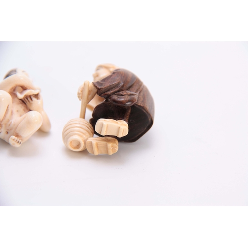 188 - A COLLECTION OF THREE EARLY 20th CENTURY IVORY AND HARDWOOD NETSUKE sculptured as various figures al...