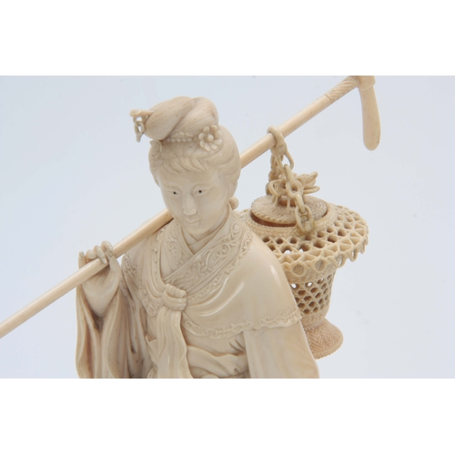 193 - A 19TH CENTURY CHINESE CARVED IVORY FIGURE OF A STANDING YOUNG LADY in elaborate costume carrying a ...