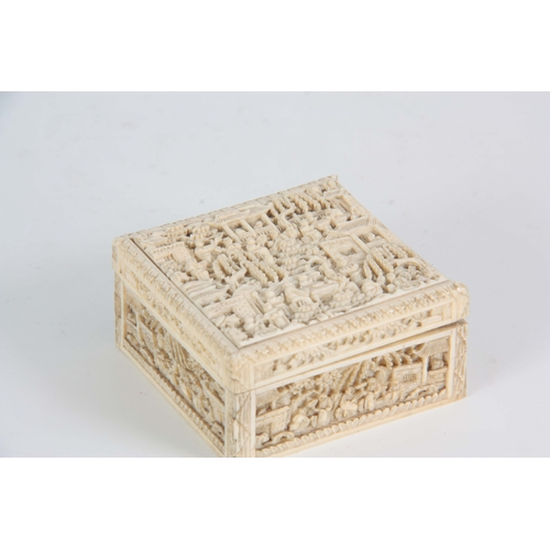194 - A 19TH CENTURY CHINESE CANTON CARVED IVORY LIDDED BOX finely decorated with figures seated under pag...