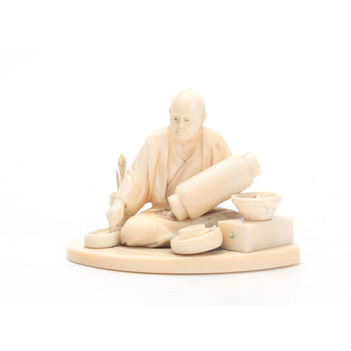 195 - A MEIJI PERIOD JAPANESE IVORY OKIMONO modeled as a seated artisan pot maker surrounded by various po...