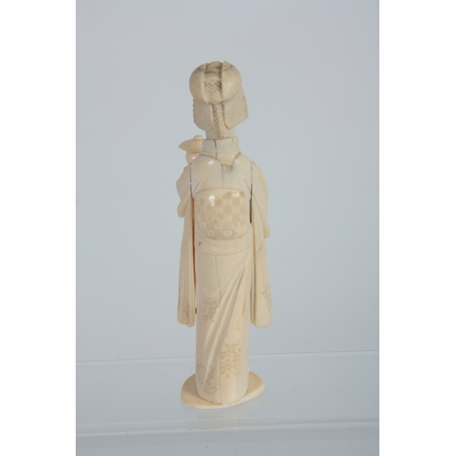 202 - A JAPANESE MEIJI PERIOD IVORY OKIMONO modelled as a Geisha with lamp 16.5cm high, signed to undersid...