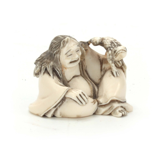 204 - A MEIJI PERIOD JAPANESE IVORY NETSUKE modelled as Gama Sennin with toad 32mm high, signature to unde...