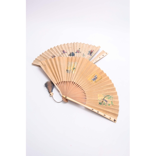 226 - TWO LATE 19TH CENTURY JAPANESE SHIBAYANA IVORY HANDLED FANS set with different raised insects to the...