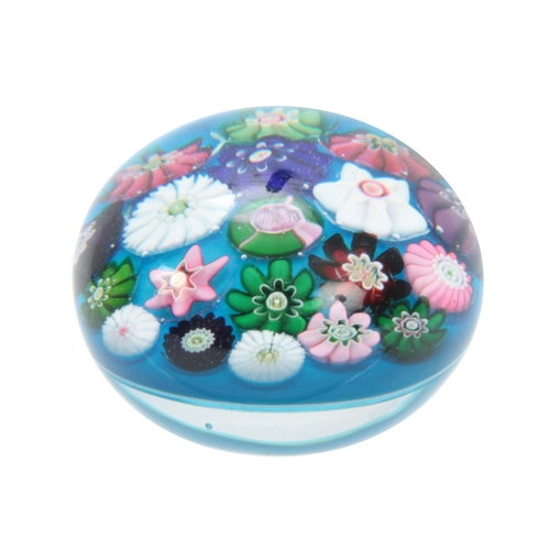 4 - A MID 19TH CENTURY CLICHY PAPERWEIGHT turquoise ground decorated with flower heads 6cm diameter....