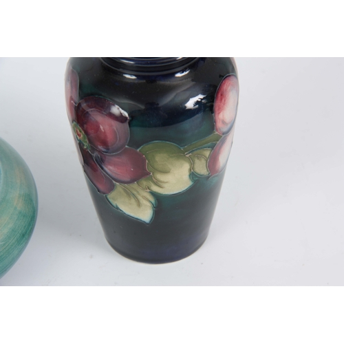 49 - A 1930's MOORCROFT SMALL TAPERING SHOULDERED VASE tube lined and decorated with a continuous band of...