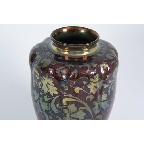 53 - AN EARLY 20TH CENTURY ROYAL LANCASTRIAN LUSTRE VASE BY GORDON FORSYTH of ovoid form with lobed shoul...