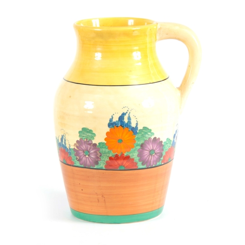 56 - A 1930'S CLARICE CLIFF GAY DAY PATTERN LOTUS JUG bearing bizarre back stamp 31cm high 22cm wide...