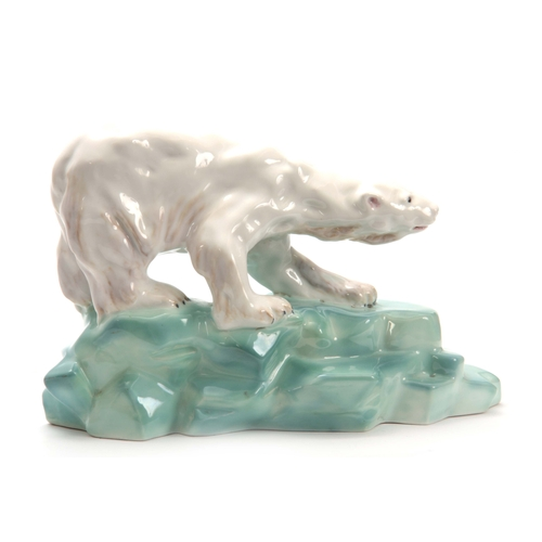 63 - A WADE PORCELAIN MODEL OF A POLAR BEAR BY FAUST LANG standing on a rocky base signed `Wade Figures` ...