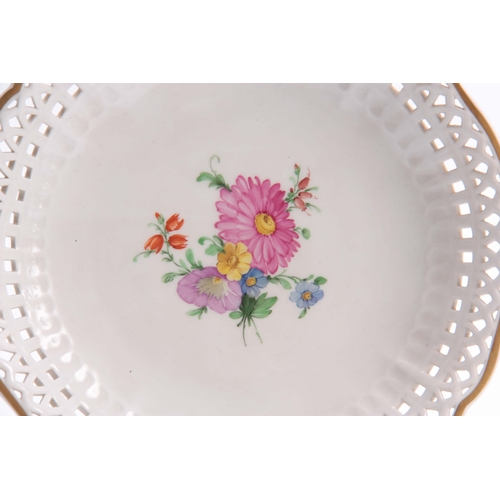 90 - A LATE 19TH CENTURY CIRCULAR KPM DISH with pierced edges and painted floral decoration 20cm diameter...