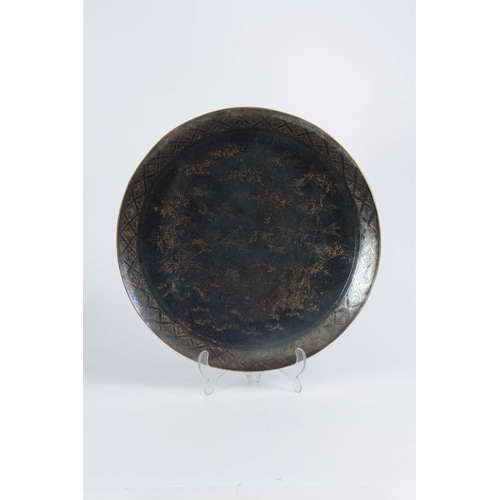 245 - A MEIJI PERIOD JAPANESE PATINATED BRONZE CHARGER WITH LUSTRE FINISH having raised decoration depicti...