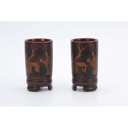 265 - A PAIR OF 18TH CENTURY CHINESE LACQUER WORK BRUSH POTS decorated with continuous figural garden scen...
