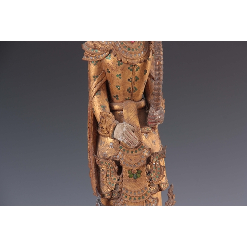 272 - A CARVED STATUE OF A WOODEN BUDDHA mounted on a square wooden base 68cm high....