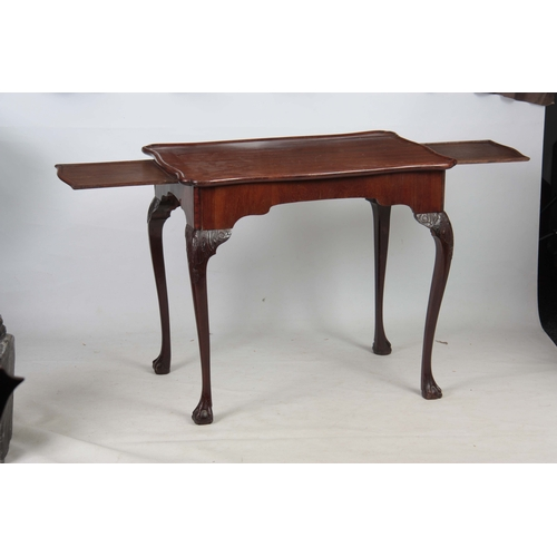 283 - A 19TH CENTURY CHINESE HARDWOOD LOW OCCASIONAL TABLE with panelled top and shaped scroll carved base...