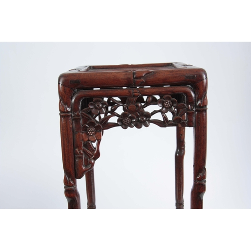 291 - A SMALL 19th CENTURY CHINESE HARDWOOD PLANT STAND of simulated bamboo design with pierced floral fre...