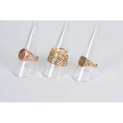 327 - A COLLECTION OF FIVE GOLD RINGS a 9ct rose gold signet ring 6.8g, a 9ct yellow gold signet ring 2.1g...
