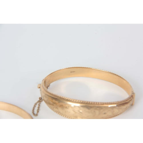 336 - TWO 9CT GOLD BRACELETS with fine foliate engraved decoration app. 21.9g...