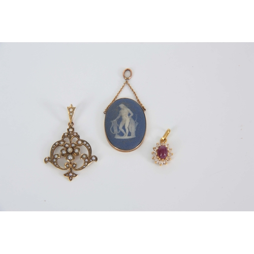 345 - A COLLECTION OF THREE VINTAGE GOLD PENDANTS to include a 10ct gold and Wedgewood oval pendant 29mm o...