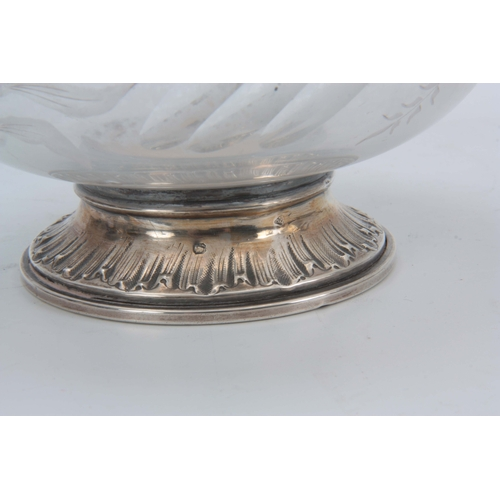 376 - A PAIR OF EARLY 19TH CENTURY CONTINENTAL SILVER MOUNTED BULBOUS DECANTERS the swirl fluted bodies wi...