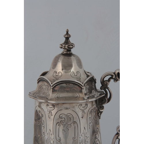 380 - A MID 19th CENTURY SILVER COFFEE POT having a domed hinged lid with a fluted engraved body and scrol...