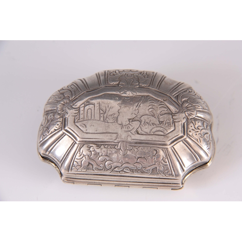 384 - AN 18TH CENTURY CONTINENTAL SILVER PILL BOX of scalloped form depicting a religious scene to the hin...