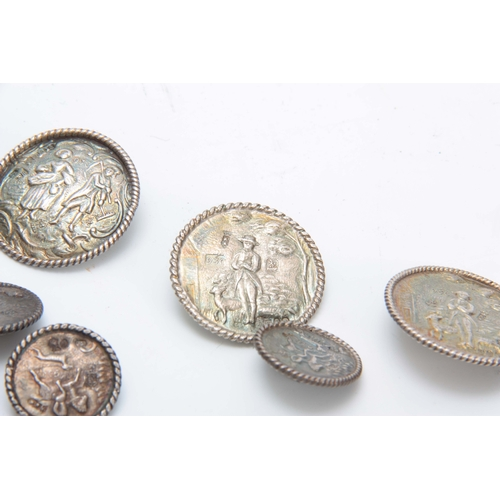 389 - A SET OF LATE 19th CENTURY SILVER BUTTONS having four large buttons, 34mm diameter, and twelve small...