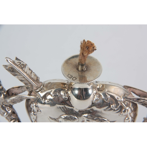 396 - A LATE 19th CENTURY SILVER HEART SHAPED OIL LAMP with relief winged cherub heads and fairy handles o...
