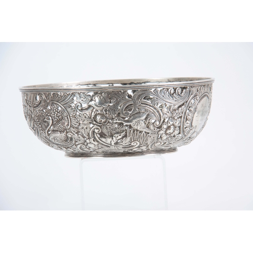 403 - A FINE 18th/19TH CENTURY IRISH SILVER PIERCED AND REPOSE BOWL decorated with a leprechaun, birds and...