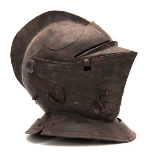 431 - A CLOSE HELMET with a one-piece skull and comb, and hinged visor 31cm high...