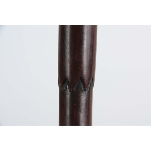 439 - A 19TH CENTURY ROSEWOOD WALKING STICK of tapering form with carved figuratively pommel depicting a b...