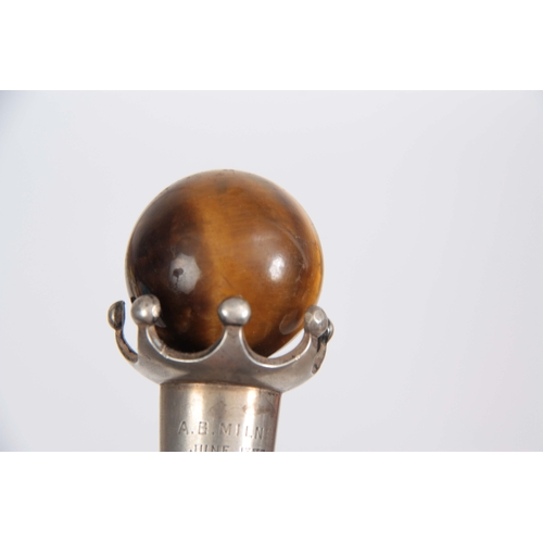 451 - A LATE 19th CENTURY ROSEWOOD WALKING CANE with spherical tigers eye handle on crown style mount, ins...