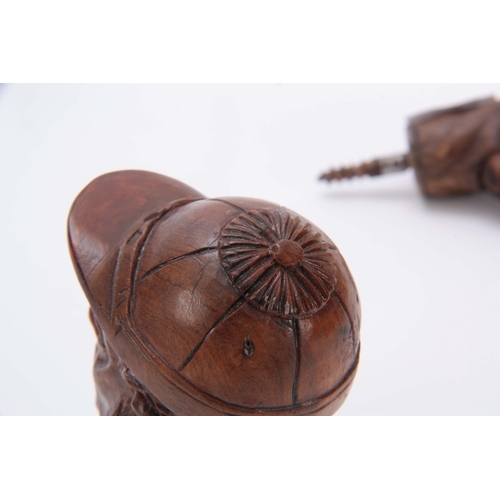 452 - A COLLECTION OF THREE  EARLY 20th CENTURY CARVED WOODEN NOVELTY WALKING STICK HANDLES the larger mod...