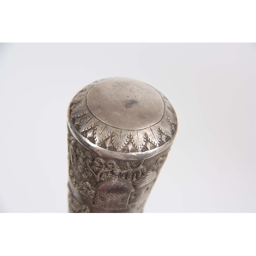 456 - A LATE 19th CENTURY MALACCA AND INDIAN SILVER METAL WALKING CANE the relief work handle depicting wo...