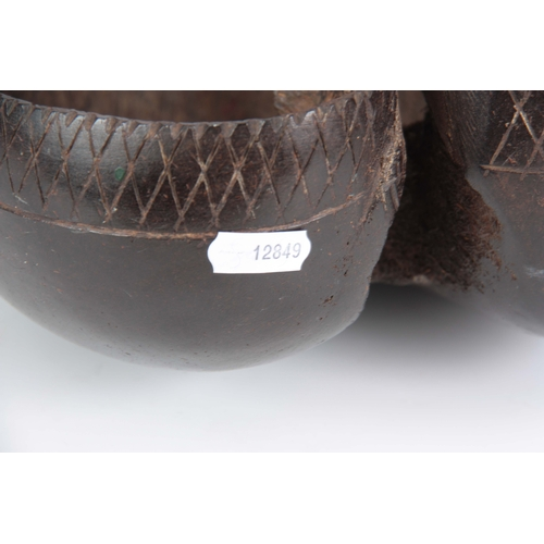 486 - A COCO DE MER (Lodoicea Maldivica) made into a carrying basket with engraved border and polished ext...