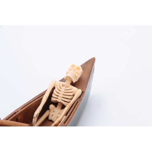 493 - AN UNUSUAL EARLY 20th CENTURY MODEL ROWING BOAT WITH IVORY SKELETON 24cm long...
