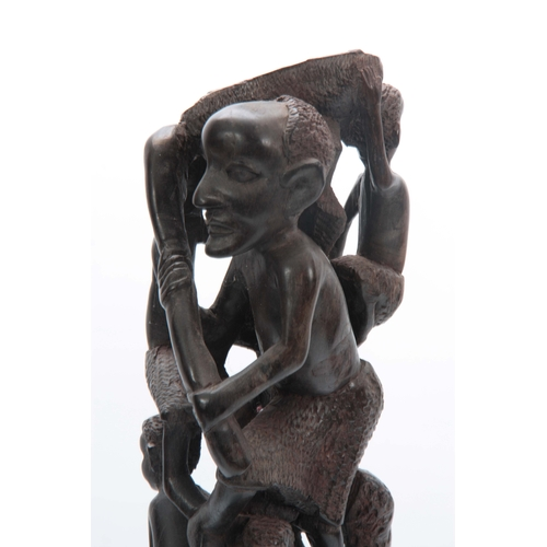 497 - AN AFRICAN CARVED HARDWOOD FIGURAL STATUE 61cm high....