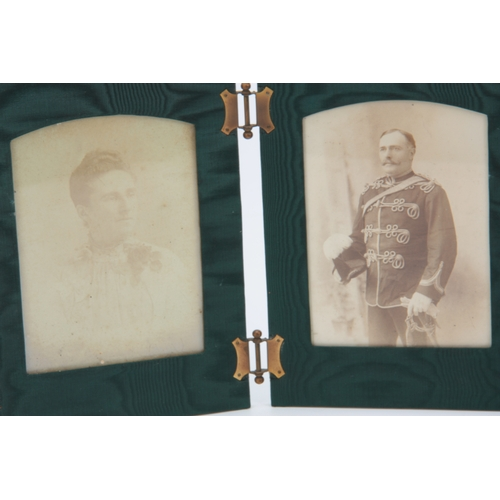 517 - AN EARLY 20TH CENTURY BLACK ALLIGATOR SKIN FOLDING TRAVELLING PHOTO FRAME with black and white photo...