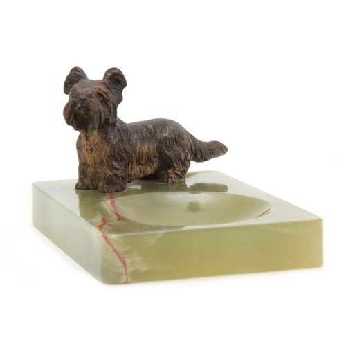 522 - AN EARLY 20th CENTURY AUSTRIAN COLD PAINTED BRONZE SCULPTURE modelled as a terrier mounted on onyx b...