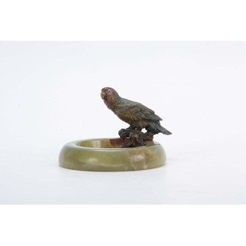 525 - A LATE 19TH CENTURY COLD PAINTED BRONZE SCULPTURE of a perched Parakatte on the rim of a circular On...