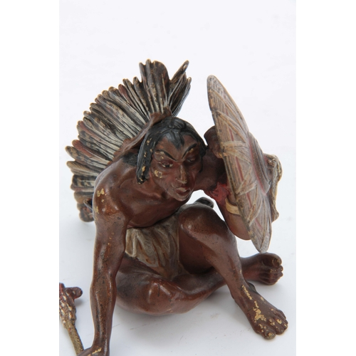 540 - FRANZ BERGMAN A LATE 19TH CENTURY AUSTRIAN COLD PAINTED BRONZE FIGURE of a seated red Indian with ax...