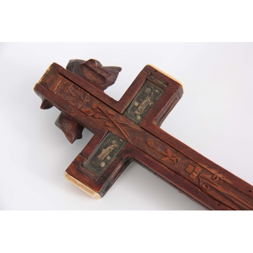 547 - A 16TH/17TH CENTURY ITALIAN FINELY CARVED WALNUT RELIQUARY CROSS WITH BONE TIPPED EDGES the high rel...