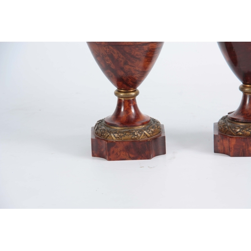 551 - A FINE PAIR OF 19TH CENTURY BURR YEW-WOOD ORMOLU MOUNTED URNS with flame finials and bulbous ringed ...