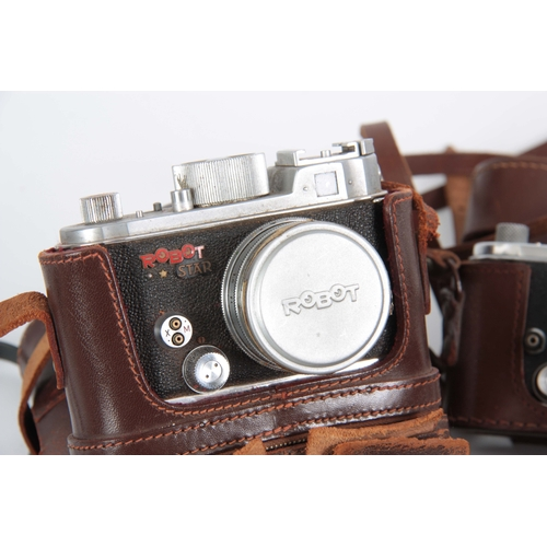 553 - A GERMAN BERNING ROBOT CAMERA with Robot Carl Zeiss lens in leather case and a Schneider Xenar lens....