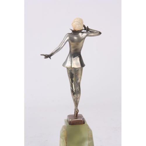 576 - JOSEF LORENZL. AN ART DECO COLD-PAINTED SILVERED-BRONZE AND IVORY SCULPTURE formed as a dancer with ...