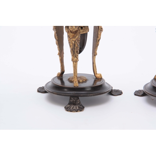 579 - A PAIR OF REGENCY BRONZE AND ORMOLU CANDLESTICKS / INCENSE BURNERS with removable scones and mask he...