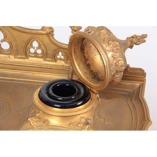 581 - A 19TH CENTURY GILT BRONZE PERSIAN STYLE INK WELL / DESK STAND with hinged Turkish domed top inkwell...