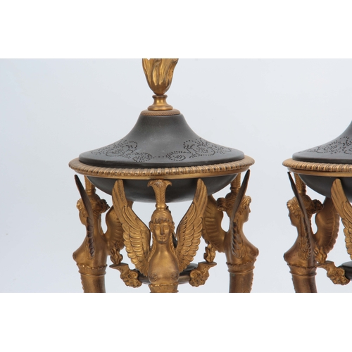 597 - A PAIR OF 19th CENTURY BRONZE AND ORMOLU EGYPTIAN STYLE CASSOLETTES designed for potpourri, the base...