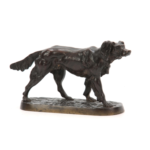 605 - A LATE 19th CENTURY PATINATED BRONZE SCULPTURE modelled as a standing gun dog on naturalistic base 1...