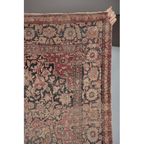 607 - A MULTI-COLOURED 19TH CENTURY PERSIAN RUG with floral border and medallion centre 218 long, 134cm wi...