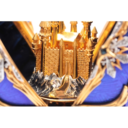 633 - A 20TH CENTURY HOUSE OF FABERGE. THE STAR OF THE NORTH JEWELLED EGG BY THE FRANKLIN MINT gilt silver...